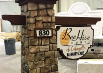 Beehive Faux Stacked Stone Column with Faux Wood Arm and Embossed Sign Panel