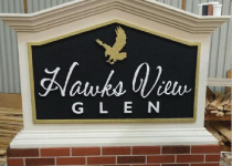 HOA Entrance Sign Monument with Faux Brick Base and Embossed Sign Panel